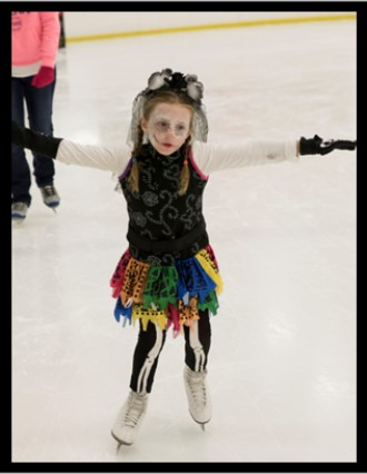 Girl ice skating in Halloween costume
